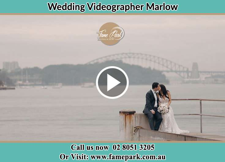 Bride and Groom kissed while sitting near the shore Marlow NSW 2775
