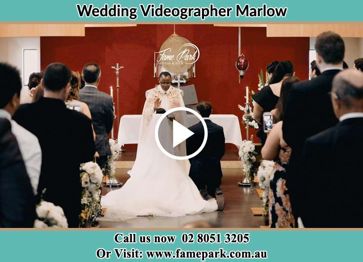 Bride and Groom Kneeling at the altar Marlow NSW 2775