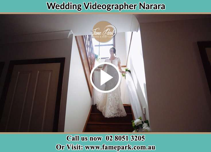 Bride getting down the staircase Narara NSW 2104