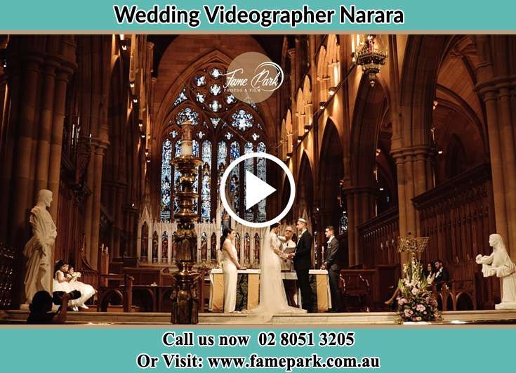 Bride and Groom hold hands at the altar Narara NSW 2104