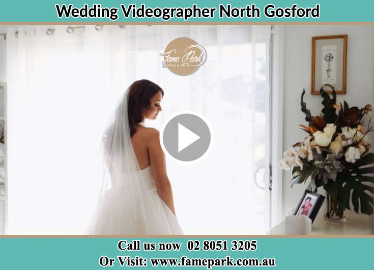 Bride already prepared standing near the window North Gosford NSW 2250