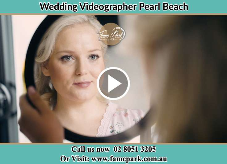 Bride looking at the mirror Pearl Beach NSW 2256