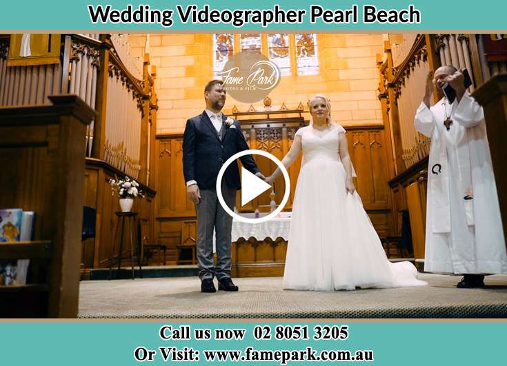 Bride and Groom at the altar with the priest prepared Pearl Beach NSW 2256