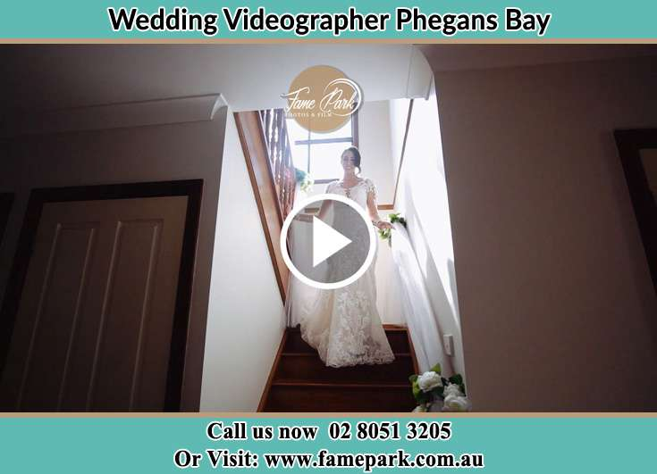 Bride walking down the staircase Phegans Bay NSW 2256