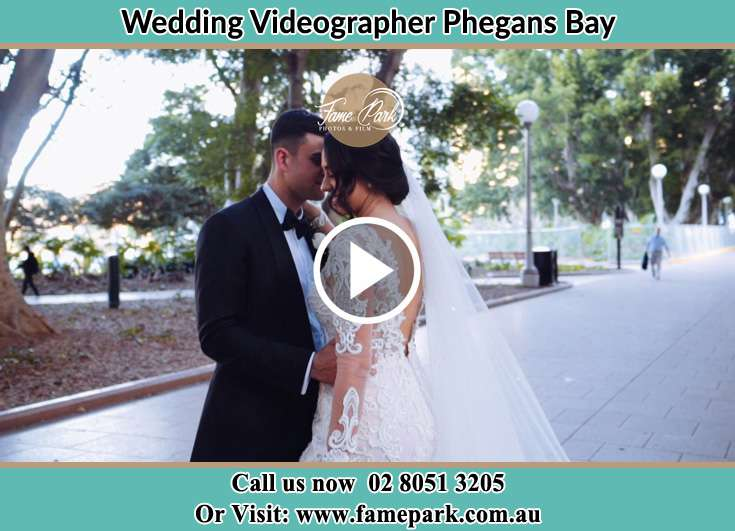 Bride and Groom hold each other at the park Phegans Bay NSW 2256