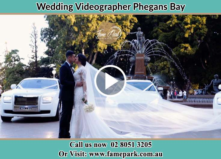 Bride and Groom kissed at the car park Phegans Bay NSW 2256
