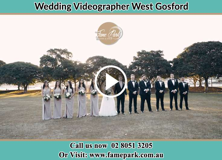 The new couple with their entourage posing for the camera West Gosford NSW 2250